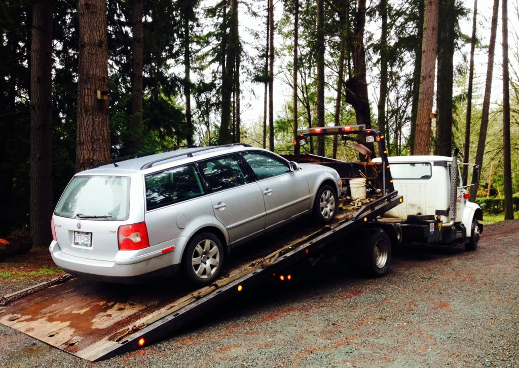VW Passat being towed